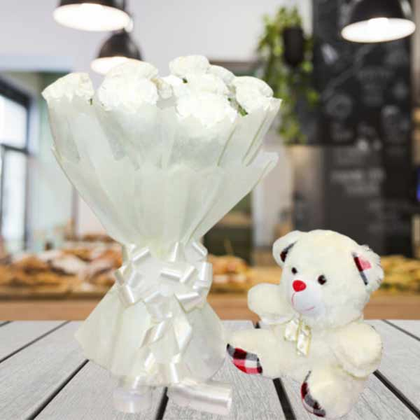 white carnations and teddy