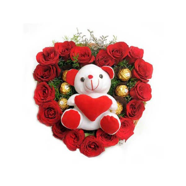 heart shape flower arrangement with teddy and ferrero