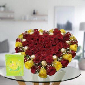 heart shape rose arrangement with ferrero