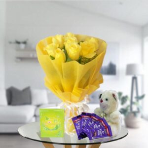 yellow roses chocolates and teddy