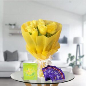yellow roses and dairy milk chocolates