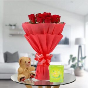 red rose bouquet and teddy