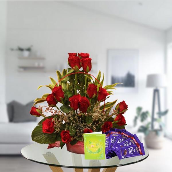 red roses arrangement and dairy milk chocolates