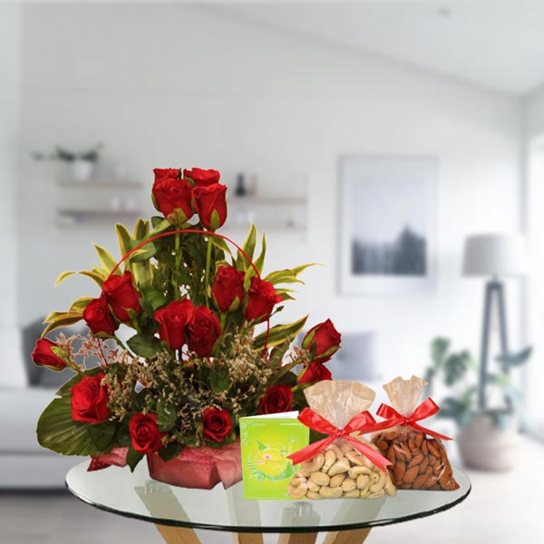 red roses arrangement and dry fruits