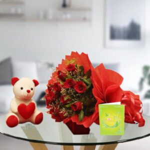 teddy bear and bouquet of red roses