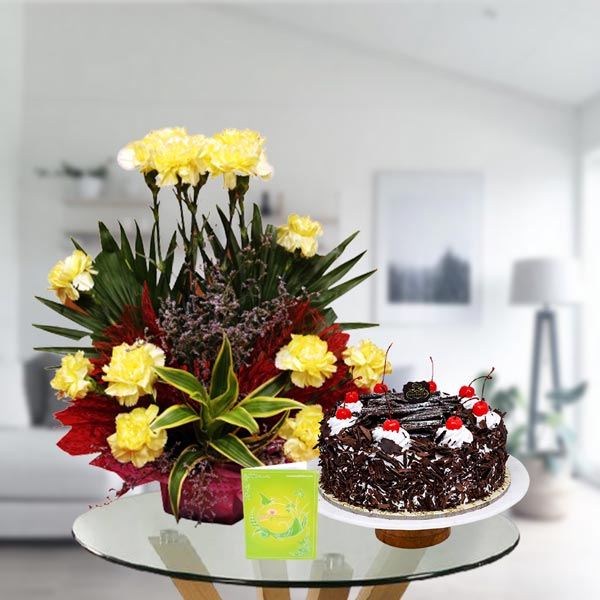 yellow carnations and black forest cake