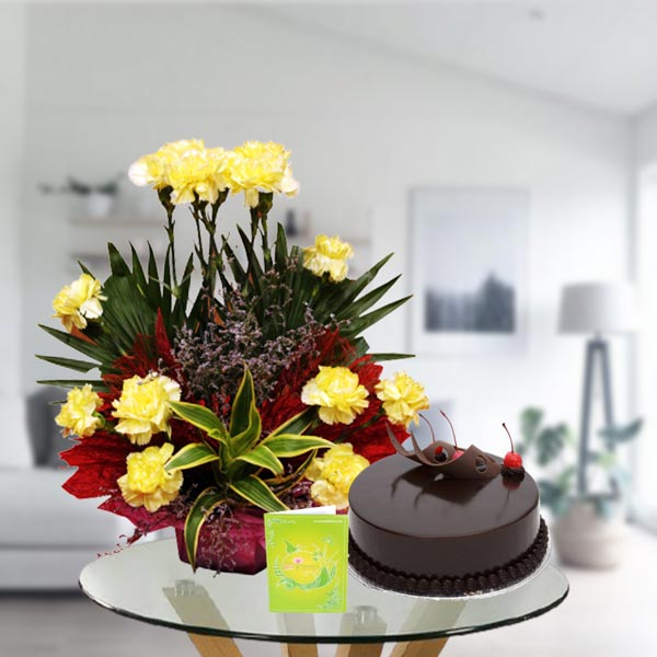 yellow carnations and chocolate cake