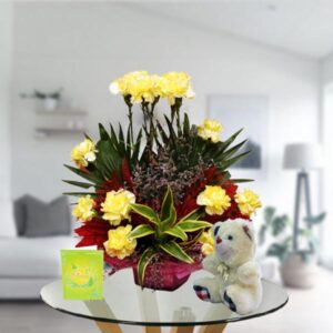 yellow carnations bouquet arrangement and teddy